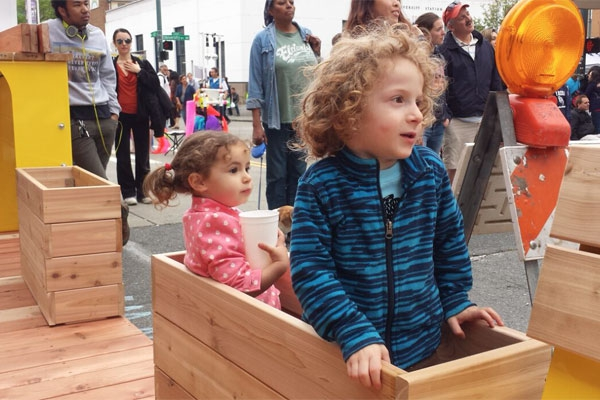 Kids Playing in the Parklet Planter Boxes During Construction - Photo by Stella Chen
