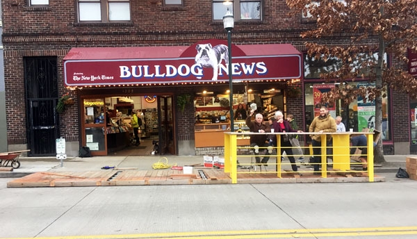 Parklet being installed at its new home in front of Bulldog News