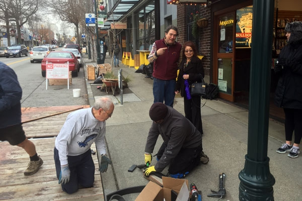 Re-assembling the parklet at its new location by neighbor volunteers.
